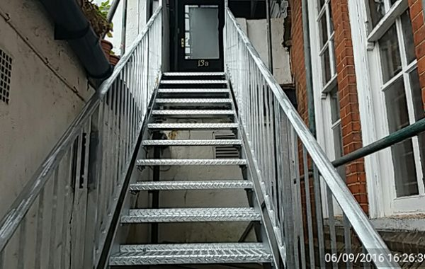 Down the rickety stairs and up a brand new set of steel fabricated ones!